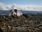 Tibet, Shigatse, Tashilhunpo Kora: The dzong as seen from the kora at the thangka wall