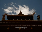 "Tibet, Shigatse, Tashilhunpo monastery: Roof of the tomb of the 5th to the 9th Panchen Lama with a gilded banner on the left and a ""normal"" with yakhair on the right"