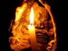 Nepal, Central Region, Bagmati Zone, Kathmandu, Bouddhanath: Candels illuminating the little Buddha statues on the toplevel of the big stupa
