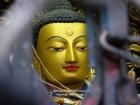 Nepal, Central Region, Bagmati Zone, Kathmandu, Swayambhunath: Golden face of Buddha in a niche of the great stupa