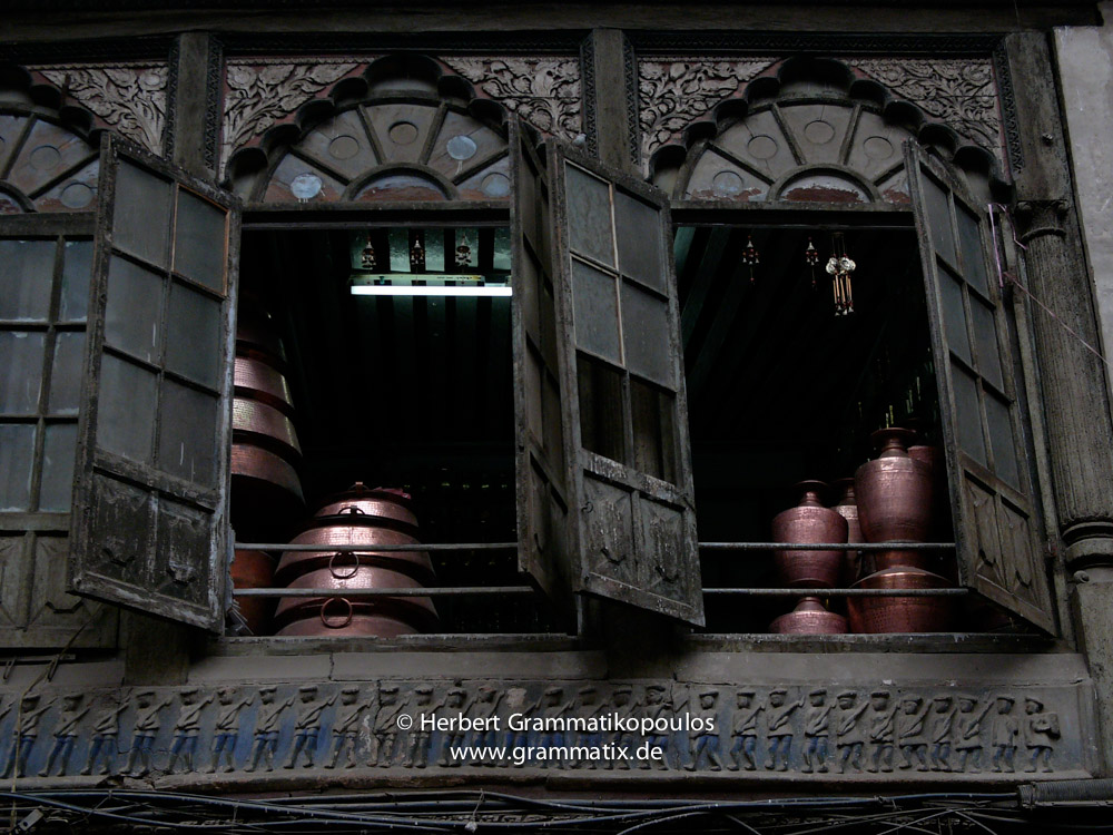 Nepal, Central Region, Bagmati Zone, Kathmandu, Indra Chowk, Bal Kumari: Detail of the Paltan Ghar, once used by the army, now stock of a metal vessel shop