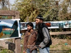 "India, Kashmir, Srinagar, Khoj International Artists Workshop 2007: Sheikh Zahoor Ahmed , Painter and teacher at government school, visits the installation ""Fragile Hope"" of H.Grammatikopoulos (Greece)"
