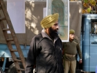 India, Kashmir, Srinagar, Khoj International Artists Workshop 2007: A armed guard of the police at  Tooraj Khamenehzadeh's (Iran) installation
