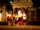 """Nepal, Central Region, Bagmati Zone, Bhaktapur, Durbar Square: Aarati-Dance. It is the process of worship offering by oil lamps to the dietes. Usually it is a process used for gods and goddesses and holy beings. As our culture consider guests to be the form of god and goddesses, we present this dance constituting the """"Aarati"""" in which Newari girls in their traditional attires will present it in the hope the peace and prosperity may shine down on us. Die Kumari beobachtet das Geschehen auf ihrem Thron im Vatsala Durga Mandir. (1/8) Venue: 6th Bhaktapur Night 2006"""