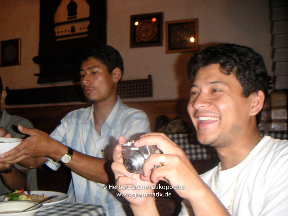 """Nepal, Patan, Durbar Square: Members of Sutra-Group Nepal in the restaurant """"Cafe de Patan"""" at Patan Durbar Square; painters Shree Bhaktar Shrestha and Manish Lal Shrestha"""