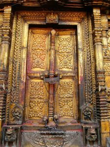 Nepal, Bhaktapur District: Changu Narayan Temple; Door covered with brass and two Talsa at the western side of the Narayan-Temple, opposite the Vishnu-Garuda temple, see also photos L1040511 to L1040 517