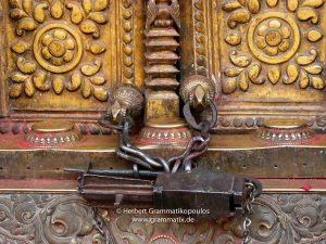 Nepal, Bhaktapur District: Changu Narayan Temple; Door covered with brass and two Talsa (here the bottom one) at the westside opposite the Vishnu-Garuda temple at the Narayan-Temple, see also photos L1040511 to L1040 517