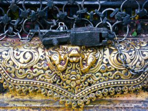 Nepal, Kathmandu, Swayambhou: Talsa at one of the niches of the great stupa