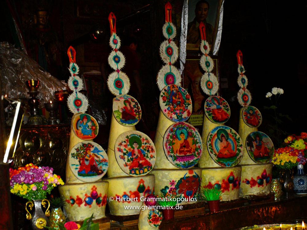 "Tibet, Gyantse, Pelkor Chöde (Baiju) Monastery:  ""tormas"", sculptures made out of roasted-barley flour in front of the statue of Sakyamuni Buddha (Sakya Thukpa) in the assembly hall"