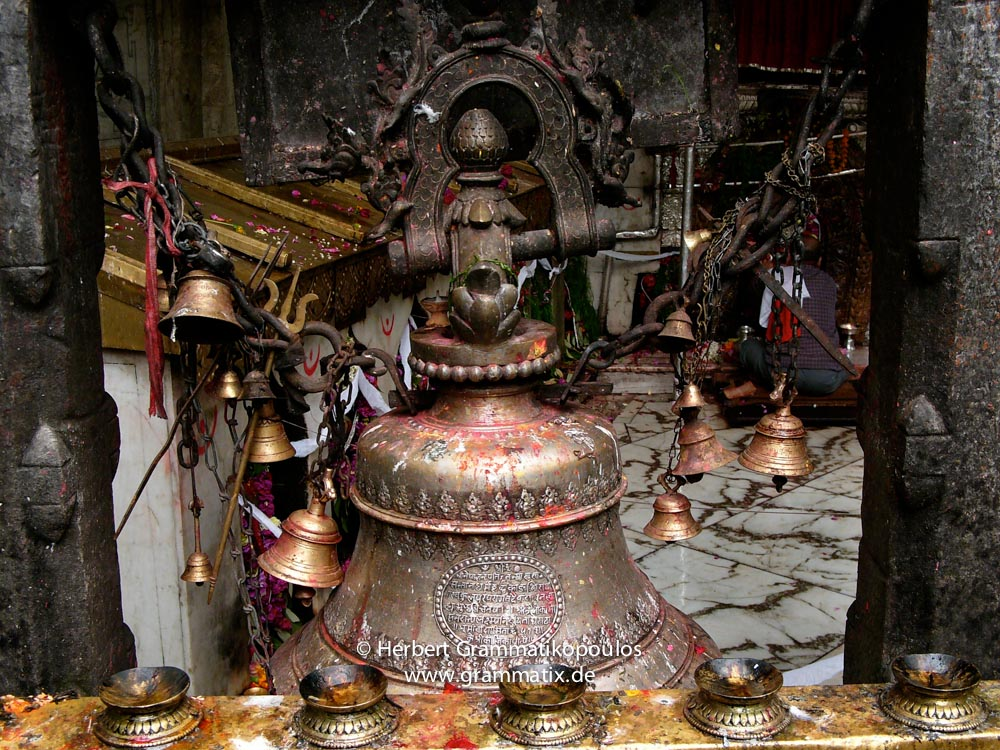 """Nepal, Central Region, Bagmati Zone, Dakshinkali Mandir: The big bell at a ceremony at the occassion of """"Janai Purnima"""". The temple is dedicated to the gory goddess Kali"""