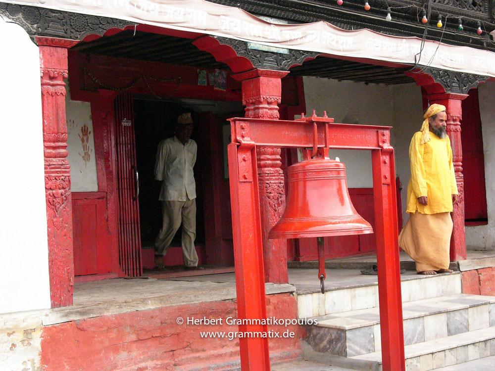 Nepal, Central Region, Bagmati Zone, Kathmandu, Teku: A sadhu leaving a temple a the Bagmati Khola