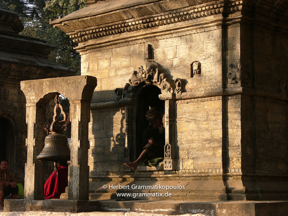 Nepal, Central Region, Bagmati Zone, Kathmandu, Pashupatinath Temple: Sadhus at the 11 chiatyas on the occasion of Shiva Rathi's night