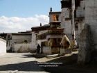 Tibet, Shigatse, Tashilhunpo monastery: A monk turning prayerwheels near the museum, close to the eastern wall of the compound