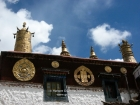 "Tibet, Lhasa, Drepung Monastery: Gilded ""dhvara""-banners, Kala Chakra - Nam chu djen (Tibetan), 8 auspicious signs and other Buddhist symbols on the roof of the Main Assembly Hall"