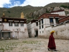 "Tibet, Lhasa, Sera Monastery: A monk coming from the ritual ""violent"" debating courtyard, on the eastern part of the compound"
