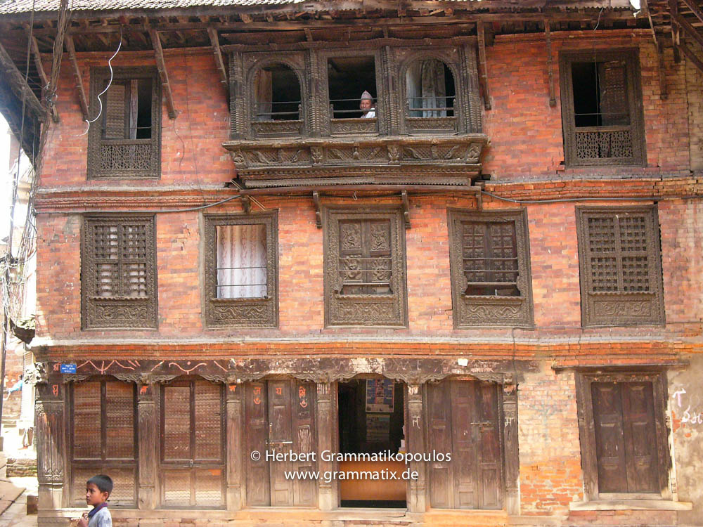 Nepal, Central Region, Bagmati Zone, Bhaktapur, Tibuche Tole: Woodcarved windows of a tradtional brick houses