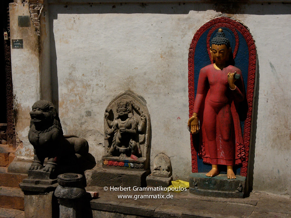 Nepal, Central Region, Bagmati Zone, Kathmandu, Swayambhunath: Stone images at the right from the entrance of the Shantipura Buildings, probably Dhyani Buddha Aksobhya