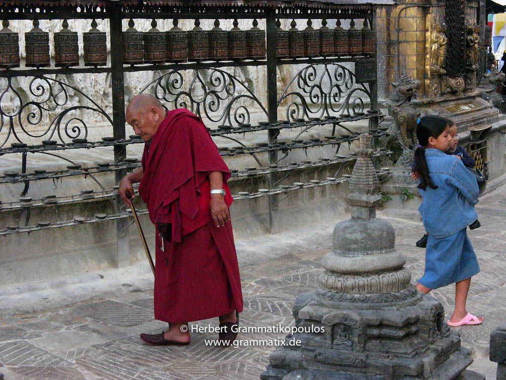 Nepal, Central Region, Bagmati Zone, Kathmandu, Swayambhou: An old monk circling round the great stupa