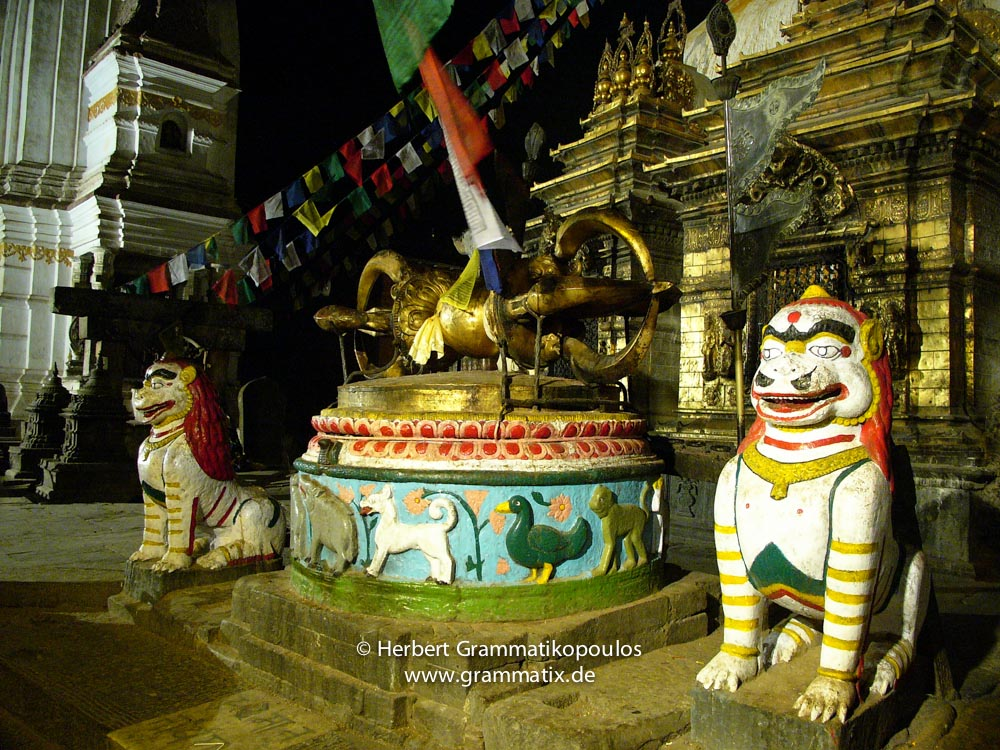 Nepal, Central Region, Bagmati Zone, Kathmandu, Swayambhu: Dorje (vajra, thunderbolt) and temple guards at the eastern stairs in new years night