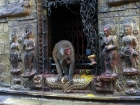 Nepal, Central Region, Bagmati Zone, Kathmandu, Swayambhou: A monkey in a niche of the great stupa