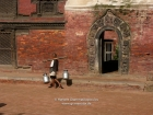 Nepal, Central Region, Bagmati Zone, Patan, Durbar Square: Porter in front of the museum