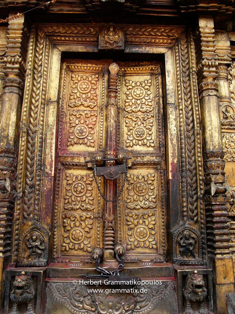 Nepal, Central Region, Bagmati Zone, Bhaktapur District: Changu Narayan Temple; Door covered with brass and two Talsa at the western side of the Narayan-Temple, opposite the Vishnu-Garuda temple, see also photos L1040511 to L1040 517