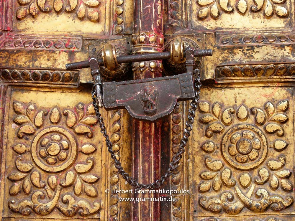 Nepal, Central Region, Bagmati Zone, Bhaktapur District: Changu Narayan Temple; Door covered with brass and two Talsa (here the center one) at the westside opposite the Vishnu-Garuda temple at the Narayan-Temple, see also photos L1040511 to L1040 517
