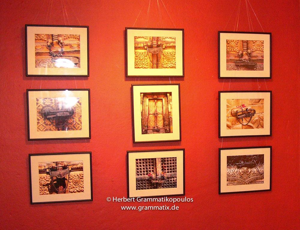 "Nepal, Central Region, Bagmati Zone, Kathmandu, Siddhartha-Gallery: Glimpse of the hanging of nine images of Nepalese locks, ""Talsa"" and a streetscene at the Gai Jatra festival"