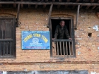Nepal, Central Region, Bagmati Zone, Pharping: Old man in a window.