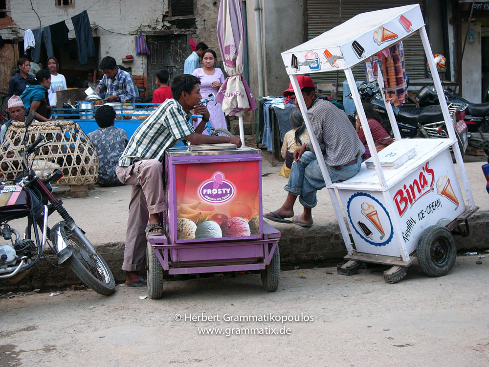 Nepal, Central Region, Bagmati Zone, Lalitpur, Patan, Lagankhel: Icecream sellers having a rest at the poultry market next to the Kumari house