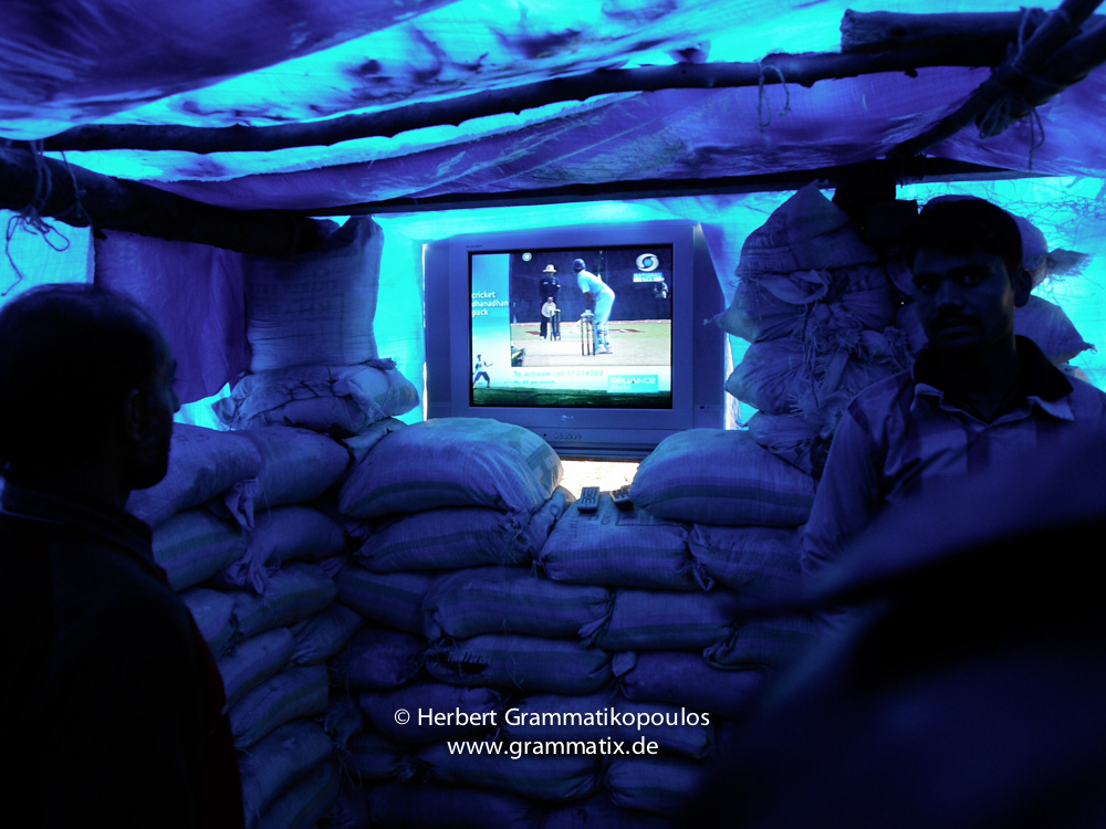 India, Kashmir, Srinagar, Khoj International Artists Workshop 2007: Bunker, Installation by Showkat Kathjoo (Srinagar). The TV shows either touristic pics of Srinagar or live the Cricket ODI match between India and Palistan, ending with the first win for India of five games.