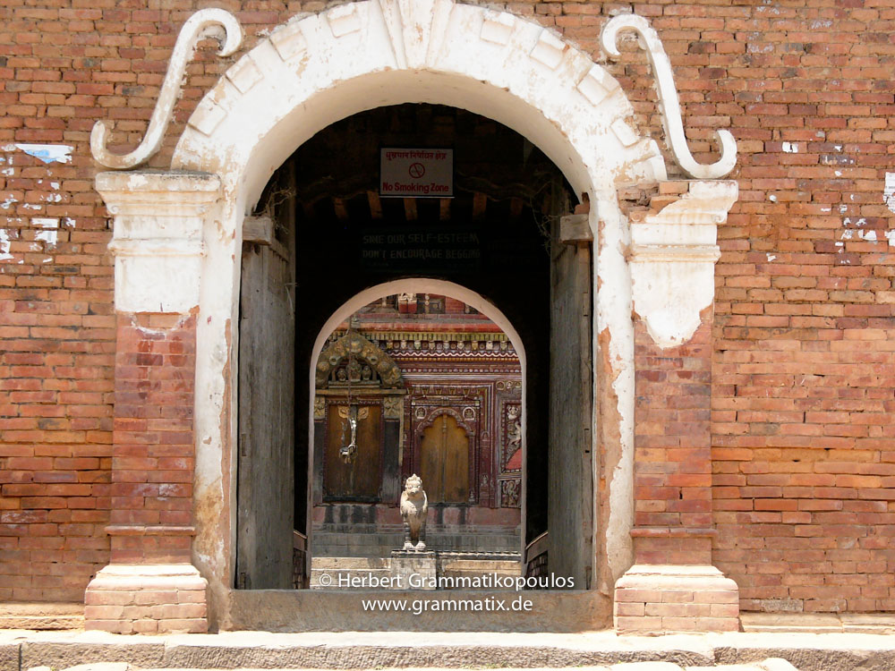 Nepal, Central Region, Bagmati Zone, Bhaktapur District: Changu Narayan Temple; The gate to the Changu Narayan temple. In the back the Narayan-Temple, dedicated to Vishnu, guarded by Garudas