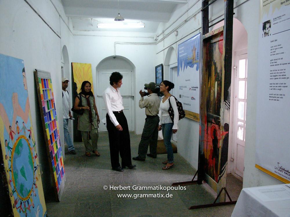 Nepal, Central Region, Bagmati Zone, Kathmandu, Bal Mandir, Khulla Dhoka Exhibition: Kantipur TV interviewing Sangeev Upreti