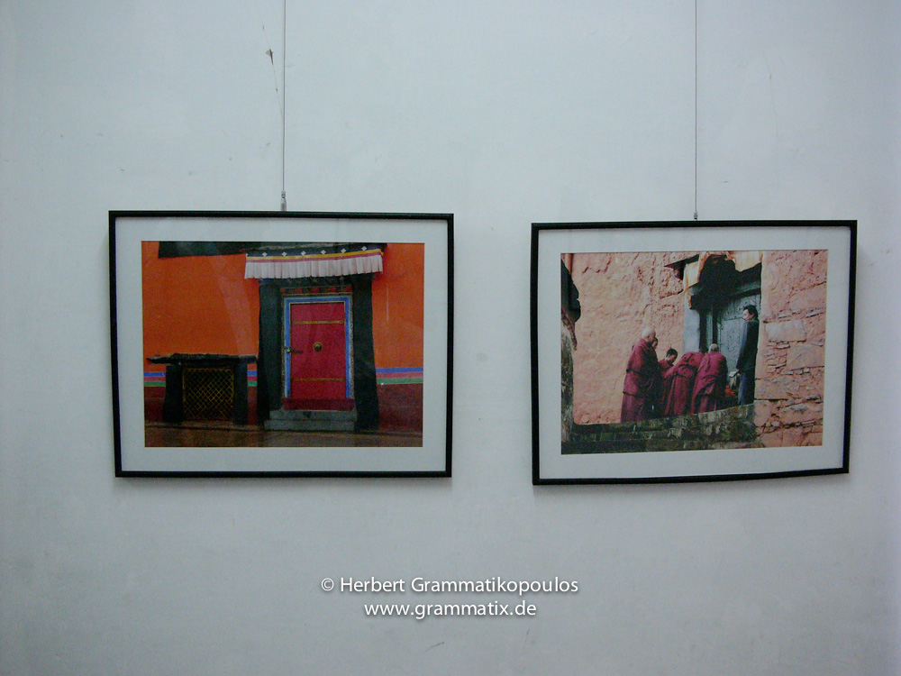 Nepal, Central Region, Bagmati Zone, Kathmandu, Bal Mandir, Khulla Dhoka Exhibition:  Two of my photographs from Tibet; left a detail from Jokhang Temple in Lhasa and on the right monks getting lunch at Zha shen Lunbu monastery in Zuangtse (Giangtse); Photos L1070 740 and L1070297