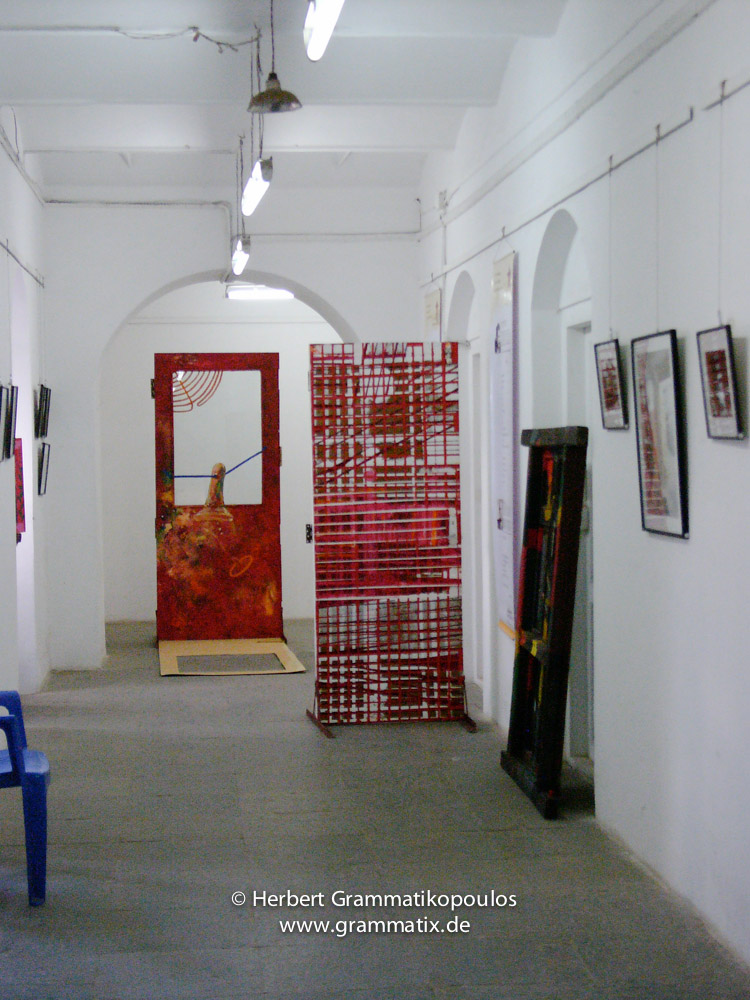 Nepal, Central Region, Bagmati Zone, Kathmandu, Bal Mandir, Khulla Dhoka exhibition: Photos of the four smaller Nepalise religions (Jain, Muslim, Sikh and Christian); in the back painted doors of Manish Lal Shrestha (see Khulla Dhoka book, page 52), Rolf Kluenter (Germany, based in Shanghai) with Sudarshan Rana (see Khulla Dhoka book, page 71) and on the right of Bikranta Man Shrestha (see Khulla Dhoka book, page 21)
