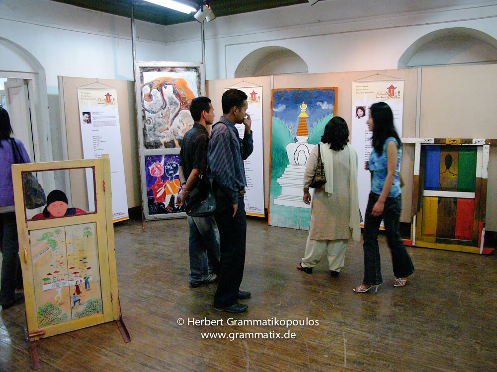 Nepal, Central Region, Bagmati Zone, Kathmandu, Bal Mandir, Khulla Dhoka exhibition: From left to right: Door of Chandra Shrestha and Wicki van der Veer (see Khulla Dhoka book, page 24), painted door of Sunil Sigdel and Shakti Samuha with poem of Dinesh Adhikari (Seite 96), door with Stupa of Lama Tashi and Tsewang Topgyal with a poem of Archana (see Khulla Dhoka book, page 44), and the door of Sunila Bajracharya and the poem of Bimela Tumkhewa (see Khulla Dhoka book, page 98)