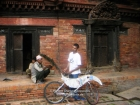 Nepal, Central Region, Bagmati Zone, Lalitpur, Patan, Sutra International Workshop at Patan Durbar Mul Chowk: Masum Chisty from Bangladesh preparing his mobile installation, the old man sitting next to him is one of the priests of Mul Chowk