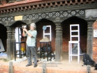 Nepal, Central Region, Bagmati Zone, Lalitpur, Patan, Sutra International Workshop at Patan Durbar Mul Chowk: Andreas Schoenfeldt from Southafrica filming the partipiciants while their preparations of the installations