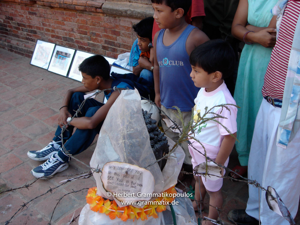 "Nepal, Central Region, Bagmati Zone, Lalitpur, Patan, Durbar Square: Spectators watching the theaatre play of Alex Gargili' theatregroup at my object ""Prisoned Peace"" at the Open Day of Sutra International Workshop"